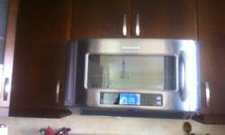 In excellent condition, stainless steel wall-mounted microwave/hood combo. Serial # YKHMS2050SS2. 2cft capacity. New would be approx $750.00. Cooking power 1,200 w. Renovating and would like to find a nice home for it :) $350.00 OBO.