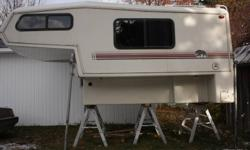 I am selling my 91 camper for 5000$$ super clean, everything is working,Fridge 3 ways, 4 Burner Range,Water Heater,Bench Dinette,Toilet/Sink/Shower East/West Bed,Fiberglass Wall. Really light. 9 1/2 foot. more pictures on request