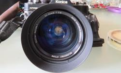 Konica built in 1978-79. We have never used this camera, so cannot attest to the quality of photos. It comes with the large lens attached as well as with the standard lens, some filters, and the camera bag. price is obo, and I do not have a cell phone, so