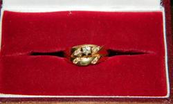 I'm selling a beautiful elegant Ladies 14K Gold Wedding set. Very simple yet elegantly designed. The ring is Size 6 and saudered together. The rings CAN BE unsaudered. Asking $600.00   Ring is being unsaudered and appraised and will post appraisal and new