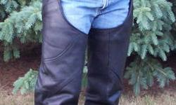 Motorcycles are great, but the wind can be cool. Stay warm, increase your riding time, and protect yourself from road rash and insects. Stylish ladies black leather chaps, size M. A removable lining and adjustable waist size fits over jeans. New