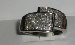 OVER 100 PRINCESS CUT DIAMONDS IN THE RING INVISIBLY SET IN 14  CARAT WHITE GOLD WEIGHING A HEAVY 5.35 GRAMS COMES WITH A CERTIFICATE VALUING THE RING AT $2875 PLUS TAXES INCLUDED IS A 1.26 AMBER COLORED CITRINE SET IN  10 CARAT WHITE GOLD OPEN TO SERIOUS