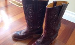 Ladies leather Frye boots. Size 7 but fit quite small...more like a size 6.5 or 6?? Excellent condition, dark brownish-auburn colour, two-inch heel. No toe scuffs. Original purchase price $375.00.