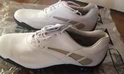 Ladies size 7 FootJoy golf shoes. Worn once at the driving range. No wear or scuffs. Perfect condition.