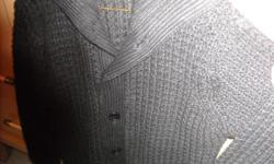 """Brand new lady's chunky, waffle knit sweater.Black in color. Size L/G. 6 buttons, longer length with 2 pockets, fold down collar.Brand new, tags still attached.""""BLUENOTES"""" 100% acrylic"""