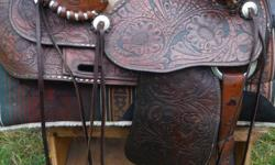 """15"""" seat, nice tooling, older saddle, comfortable, clean, cared for. Approx. 7"""" gullet."""