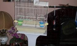 I have a large bird cage with all accerories and a stand for only 120$ can fit all birds as its bars are less than 1 inch from the other call me at 604 939 2194