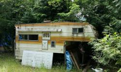 *** Going as a whole unit only - Will Not Part Out *** some dry rot and mildew, Has working propane furnace, electrical panel, 12/110 v lighting, propane stove and oven, 2 sinks, fridge, toilet, 4 jacks, awning, etc etc, aluminum paneling, would be good