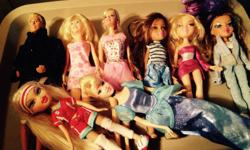 Please see photos 8 dolls total with outfits, Ken is missing pants. Please see my other ads
