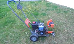 """Walk behind lawn edger in excellent condition. 3.8 HP motor 9"""" blade. 250-888-0331"""