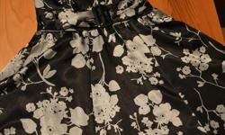 As seen in picture. Silky feel. Size XS. In excellent condition. Bought for a wedding and never worn again.