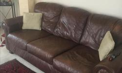 A nice brown sofa set, it is a little worn out. Was bought for $2500.