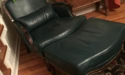 forest green leather. brass studs. mahogany wood frame just like new , comfortable for a library