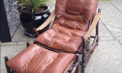 Unique chestnut brown leather chair and foot stool in excellent condition. Original price $900