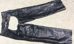 """Like new condition Leather Chaps. Size XL Left and right deep pockets. All zippers, snaps and buckle are in very good working order. No tears or scratches or frayed leg ends. Fits size 32 to 40 waist. Actual leg Length is 32"""" however will fit longer. I"""