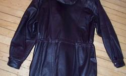 This coat is very warm, beautiful soft leather, 3/4 length, removable hood. Zips up, Then decorative buttons close it in place, there is a waist pull rope to give it a more Form Fit. It is made by ALASKA Leather Garment, MONTREAL. Size is MEDIUM. Colour