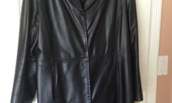 Knee length ladies black leather coat, Danier, Size 16, tapered in at the waist, excellent condition!