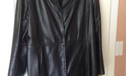 Ladies mid length ladies black leather coat ... excellent condition ... snap front ... size 16 ... Danier