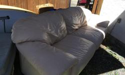 Real leather couch and chair, good condition. Couch has a little wear on back of one cushion. Cream colour