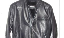 This is a Schott leather jacket for sale. Deluxe Heavy Steerhide Single Rider Leather Jacket has bi-swing back, underarm footballs, adjustable stand-up collar and side tabs, and zip-out pile lining. It is a 42 Regular. This jacket is in spectacular shape