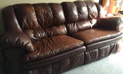 Leather full length reclining sofa made by Ashley Furniture. The full length of the sofa reclines, and is very comfortable. There is the expected wear as we've had it for about 8 years. Still in good condition though. It is easy to move as each side can