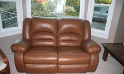 We are selling a matching leather reclining sofa and loveseat. We purchased new couches and need them gone ASAP. Bought new from the Brick two years ago. One small tear in the middle top on the sofa at the seam (see photo). $500 OBO. Thanks!