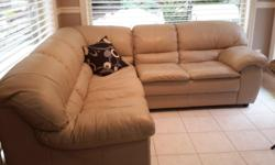 Sectional is 84 in., long and 84 in. Wide, by 33 in ., high and 34 in. Wide. Tan coloured with full leather back. New was $2200 now for sale $300.