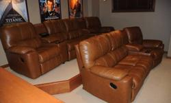 """Two rows of fully or partially reclining theatre seating by Palliser. One row of 4 seats with two drink/storage wedges and one row of 3 seats with one drink/storage wedge. In """"as new"""" condition. Original price $7,900. Asking $3,500 OBO. All components are"""