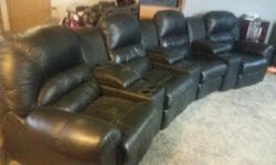 Really nice leather reclining theatre seating, high quality, with cup holders and storage compartments. 7 pieces all together. Enjoy your movie nights in style and quality. Will accept best offer..