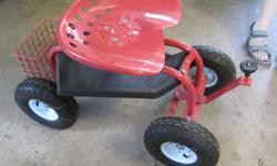 Steerable rolling garden seat with tool caddy underneath. Seat swivels. In very good condition.