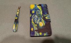 I ordered the wrong case for my Cell Phone. It's brand new and in packaging. Flip Credit Card Phone Cover Design Pouch (Starry Night) with Screen Protector and Wristlet. Can also be used as a hands free stand.