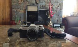 great film camera, lightly used and comes with strap and Canon 188A flash. Price is $250 OBO