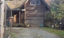 """# Bath 2 Sq Ft 1430 MLS 404285 # Bed 2 """"ONE of a kind & on three legal lots"""" Did you ever want to live """"green"""" amongst nature & off the grid? Well this is it! A log home situated on two lots with combined title, and two additional lots each w/own title."""