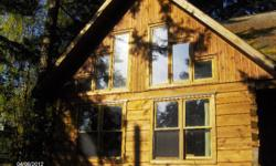 # Bath 2 # Bed 3 Square cut log Home in Nanoose Bay with lots of ocean and small island views. Custom features: oak kitchen, bathroom cupboards, bookcases, oak living room floor, propane fireplace and JennAire cookstove. Giant backyard patio with