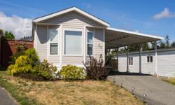 # Bath 2 Sq Ft 924 MLS 411893 # Bed 2 Bright and sunny 2 bedroom, 2 bath home in Rocky Creek Village. 924 sq ft open floor plan with vaulted ceilings and a large kitchen with eating area. Great yard with rock garden, large deck and storage shed. Very well