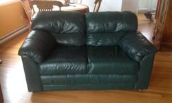 Dark green leather. Loveseat is in very good condition, chair has a few scratch marks from a cat. Cosy and Very comfortable Will take $300 for the set