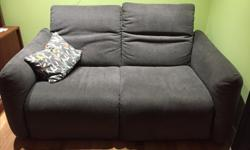 """Grey loveseat in EUC. Purchased from Structube in 2015. Relocated to different house and no longer have room for this piece. 67"""" long 41"""" deep 17"""" (from floor to seat) Very comfy and supportive. Head rest adjusts (as per pics)."""
