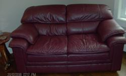 2 identical burgundy leather loveseats in excellent, clean condition. Good quality. $300 each. E-mail or call Barb at (250) 752-3323