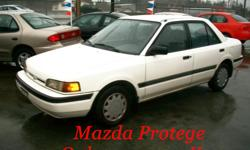 Make Mazda Year 1996 Colour ARCTIC WHITE Trans Manual kms 111000 *** LOW, LOW KMS !! ONLY ....111,000 KMS on this MAZDA !! *** WOW !! Such low kms are hard to find in an economically priced 4-cylinder car. This Mazda Protege is in absolutely fantastic