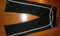 """In excellent condition,Quick Dry material,Black with White ,inseem hemmed to 29"""".Tall person can wear it as a crops.orig.$98,now $40 for Fast sale.Matching Running shirt in size 6 available for $40 and matching jacket available in size 8 for $50 REPLY"""