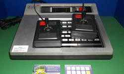 Item: This is the Magnavox Oddyssey 2 console! This unit has been fully tested and works well. Comes with two controllers and all the cords required to get it going. We also have a decent selection of both loose and complete games for the system. All