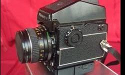 Mamiya 645 Single Lens Reflex Camera System with CdS Prism Viewfinder, Power Drive, Bellows Lens Hood, Standard 80 mm f2.8 lens, plus 150 mm f3.5 lens. Never used. Price at time of purchase $2500+ now sacrificing for $495.