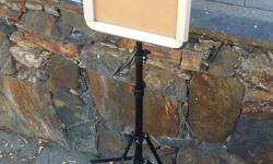 Tripod design. Telescopic pole. Sign clips on. Aluminum / Alloy frame. Screw on pro lighting kits. Sign screws off. Some finish rubbed off on side. Small crack on back in sign panel.