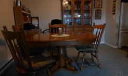 Oak table with leaf and six chairs, plus includes two piece cabinet. All very well kept set but we are relocating and unable to take with us.