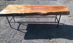live edge maple coffee table mounted on nice sturdy black steel legs.