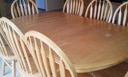 """Solid maple pedestal table - measures 48"""" when closed and opens to 72""""(6 ft) with two leaves. comes with 8 chairs. In great condition. located at Brownlee Asking $950"""