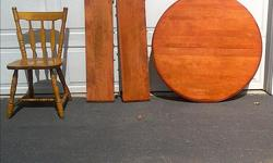 Maple dining table with two leafs and five chairs. Table has 4 black legs not shown. Table was refinished by owner.