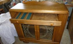 Solid Maple Excellent Condition Two Drawers Two Doors Doors Feature Leaded Glass Dimensions: 42 Inches Long X 16 Inches Deep X 40.5 Inches High