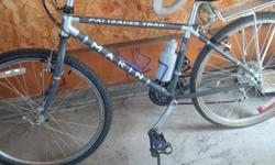 """Marin Palisades Trail Bike in great shape - 18"""". Comes with toe clips, bag rack, bottle holders, and all the accessories. Garage kept and has no rust. Needs a new back tire as it hasn't been ridden in a couple years. Paid top dollar at Marty's but don't"""