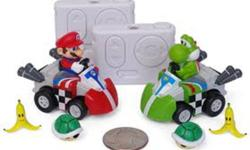 BRAND NEW IN PACKAGE! Yours for $35, retails for $59.99 plus taxes ONLY 1 LEFT!   Race Mario and Yoshi while battling with power ups! Contents: 2 X Mario Kart characters, 2 X Controller/Charger, 1 X Paper Track Set, 1 X User Instruction Guide   Get your